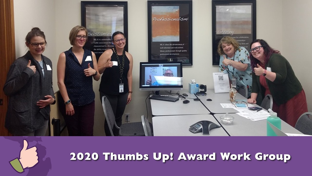 2020 Thumbs Up! Work Group - group photo of members giving a Thumbs up sign